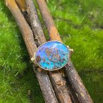 Natural Solid Australian Boulder Opal Ring set in 14k Gold Saturated with Hues of Purples, Blues and Greens